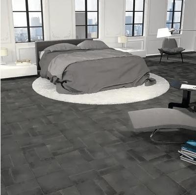 laminato ò grès porcellanato: un grès color antracite per una camera da letto in stile industriale