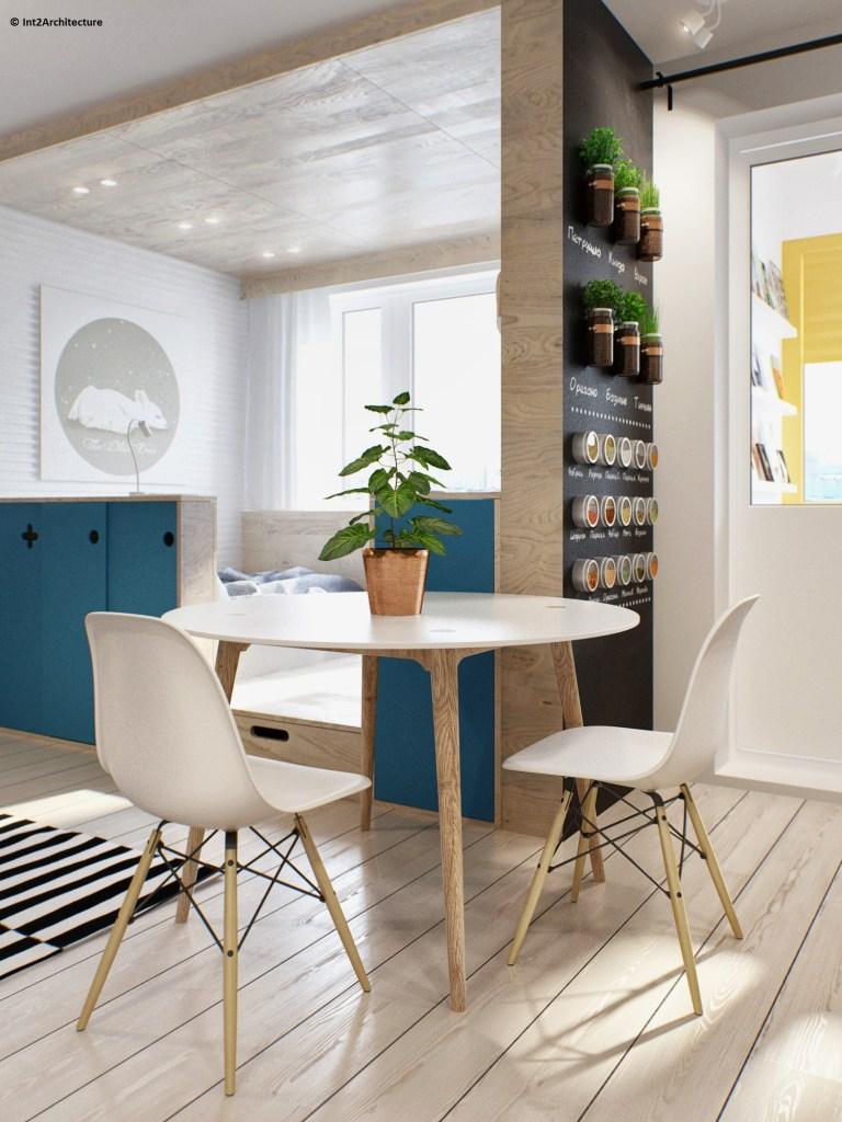 tavolo da pranzo rotondo in stile nordico con sedie nello stesso stile, tutto bianco