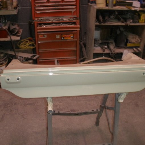 The rear valence is then sprayed in its final top coat of L87 Pearl white