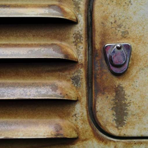 patina a plenty on this rear vent/fuel flap detail of this split screen bus