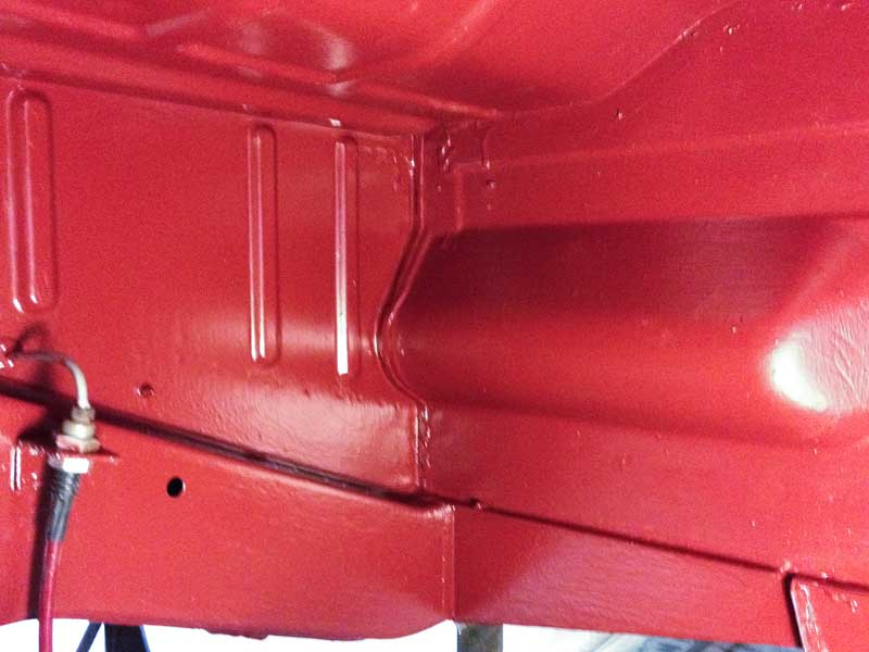 front wheel arch transformation with second and final coat of the red oxide coloured Epoxy Mastic 121