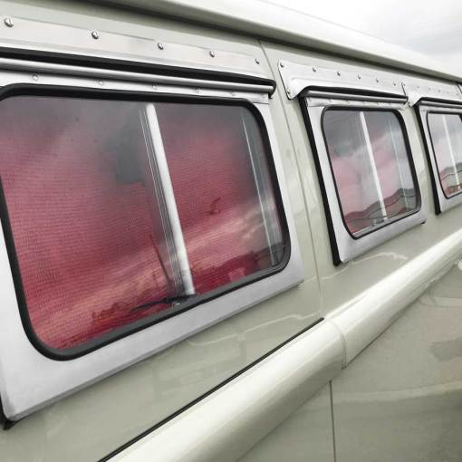 cool vertically opening side windows
