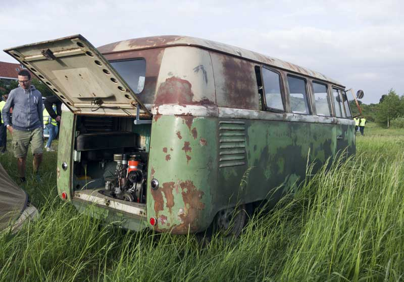 barndoor buses blending in with the environment