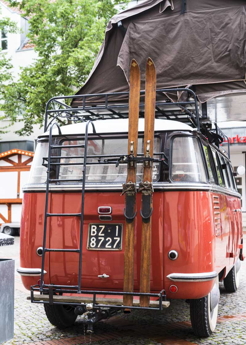 ready for an adventure with skis and rooftop camping