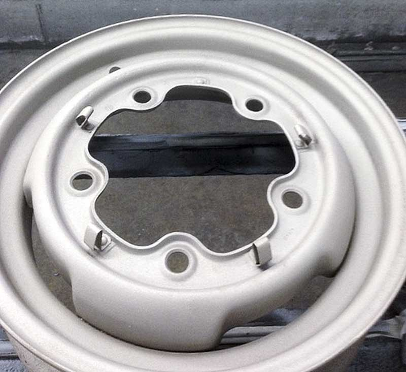 """the original 15"""" VW wheels back to bare metal and looking factory fresh again!"""