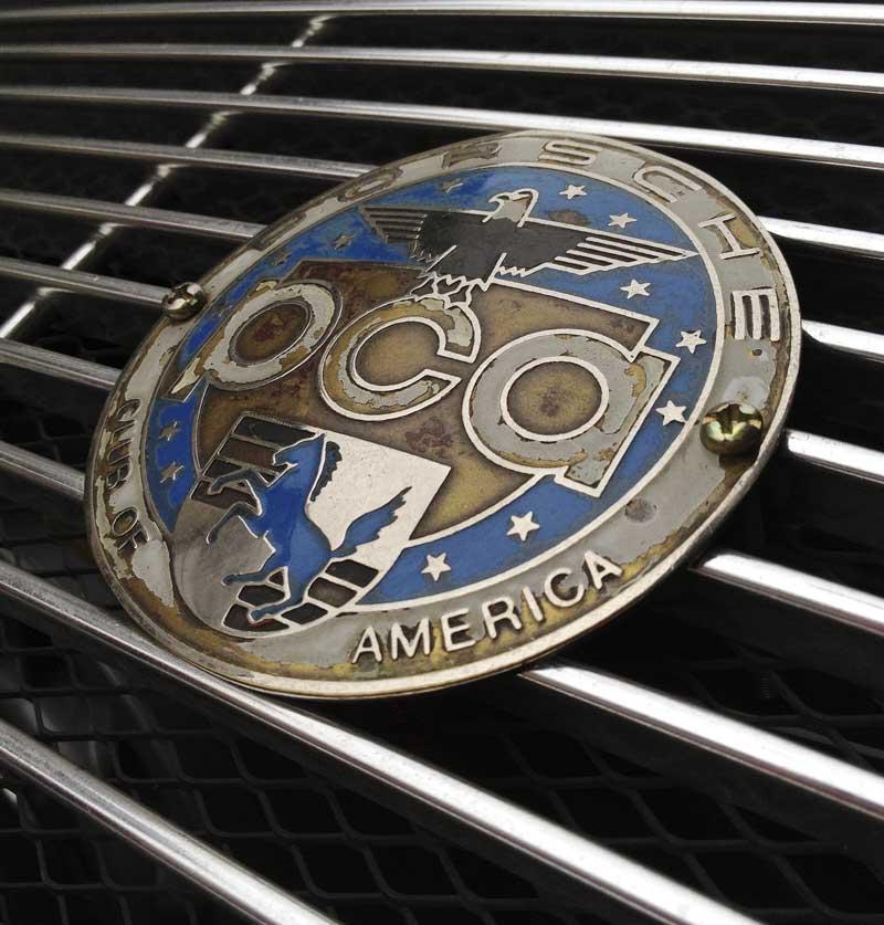 distressed vintage Porsche Club of America Badge