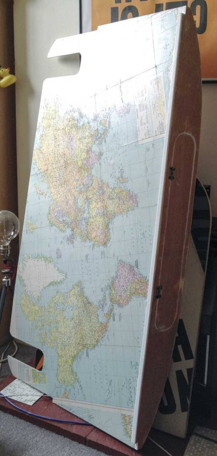 vintage world map for the base of the overhead locker