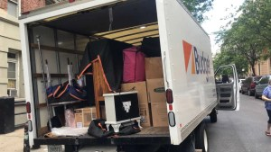 One of our trucks, loaded with packed boxes and belongings for your local move.