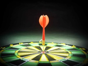 A dartboard and a dart in its center