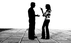 A customer talking to a moving representative, male and female black silhouette