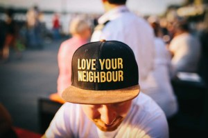 Love your neighbor written on a ball cap