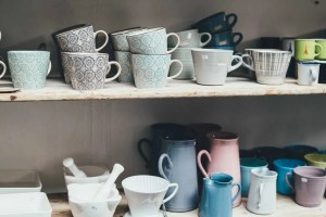 Tea cups sitting on a shelf - time do declutter your home if you don't have use for them all.