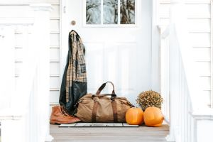 A bag sitting on a porch