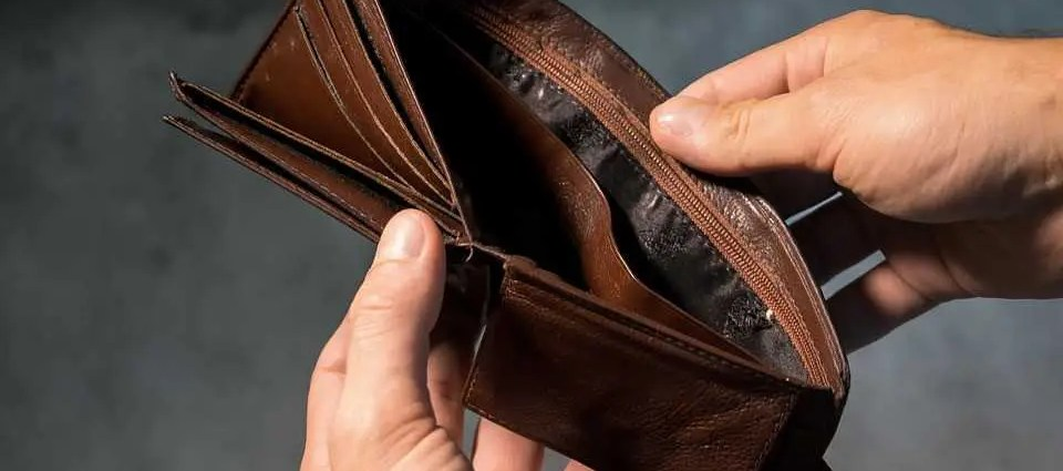 An empty wallet - a sign that you have to find ways to save money.