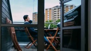 Man sitting on the chair on the apartment terrace