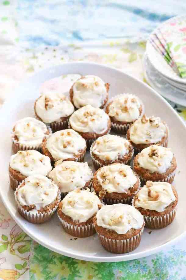 Banana Bread Mini Muffins on a platter with plates and napkins beside.
