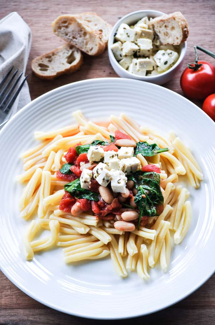 Vegan Tofu Feta with Tomato, Spinach, and White Bean Pasta https://www.veganblueberry.com