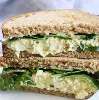 Cut Vegan Egg Salad Sandwiches stacked on top of one another