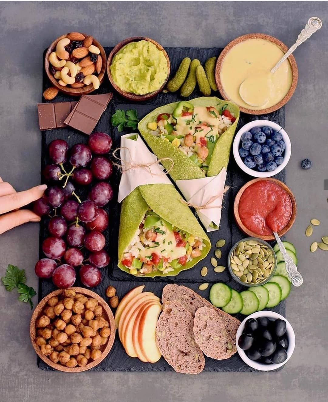 delicious vegan platter with homemade spinach wraps i also display image  a654cb74