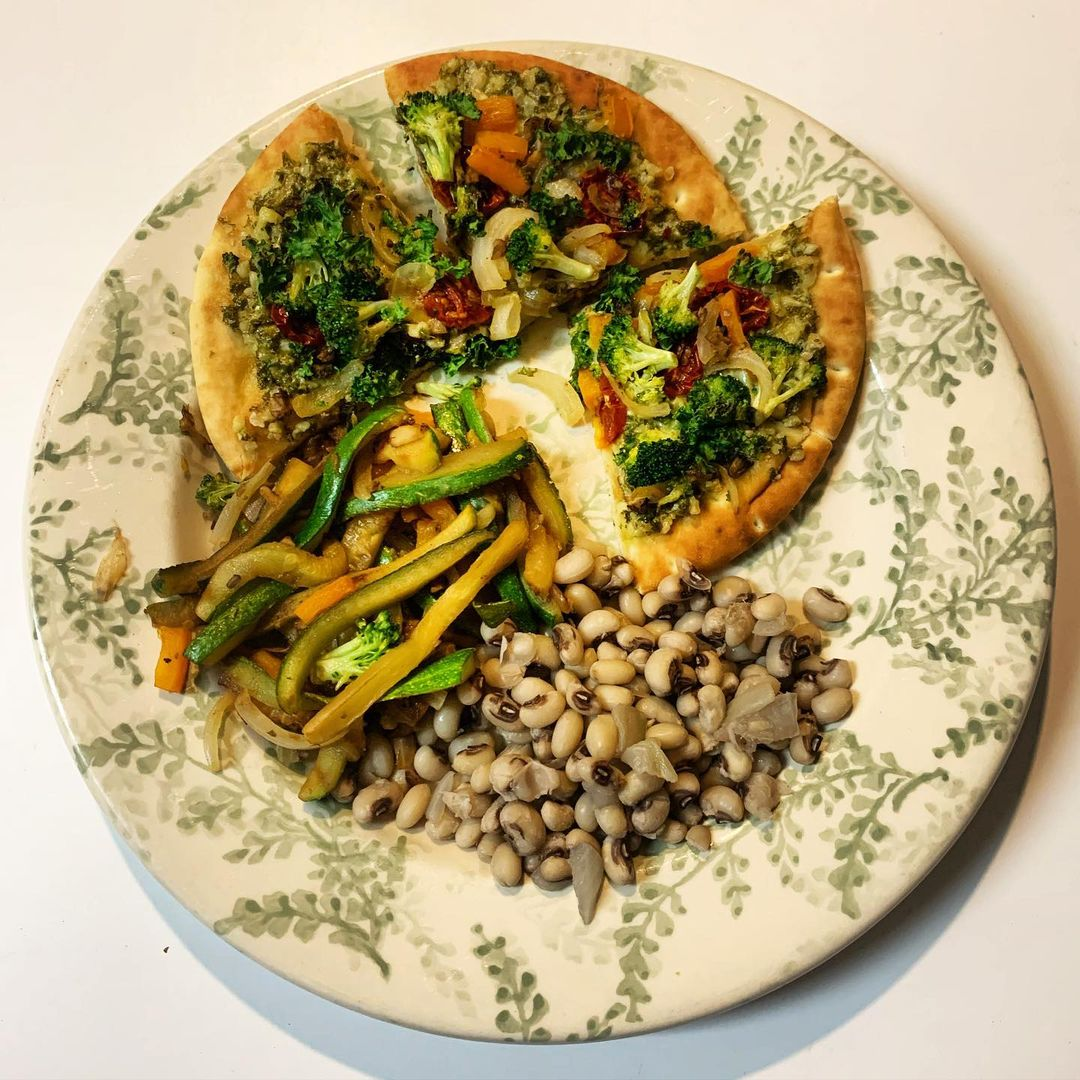 kale and cashew pesto pita pizza with black eyed peas and ve display image  68a0612f