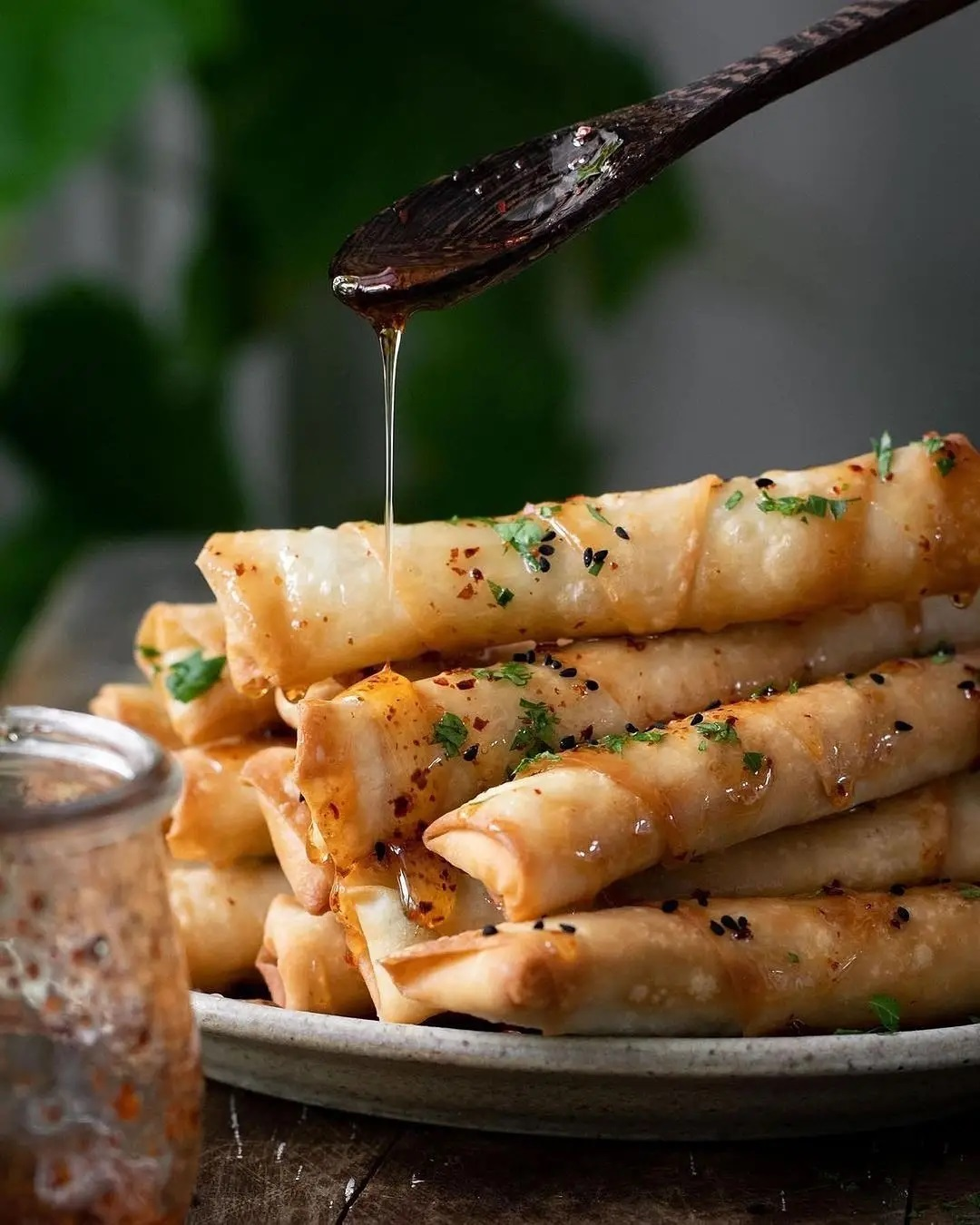 crispy vegan cheese & herb rolls drizzled with aleppo chili display image ac