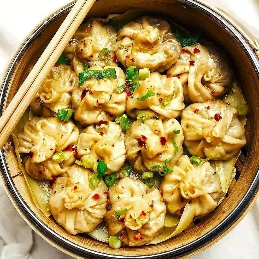 dumplings with a sweet & sour cabbage mushroom filli display image face
