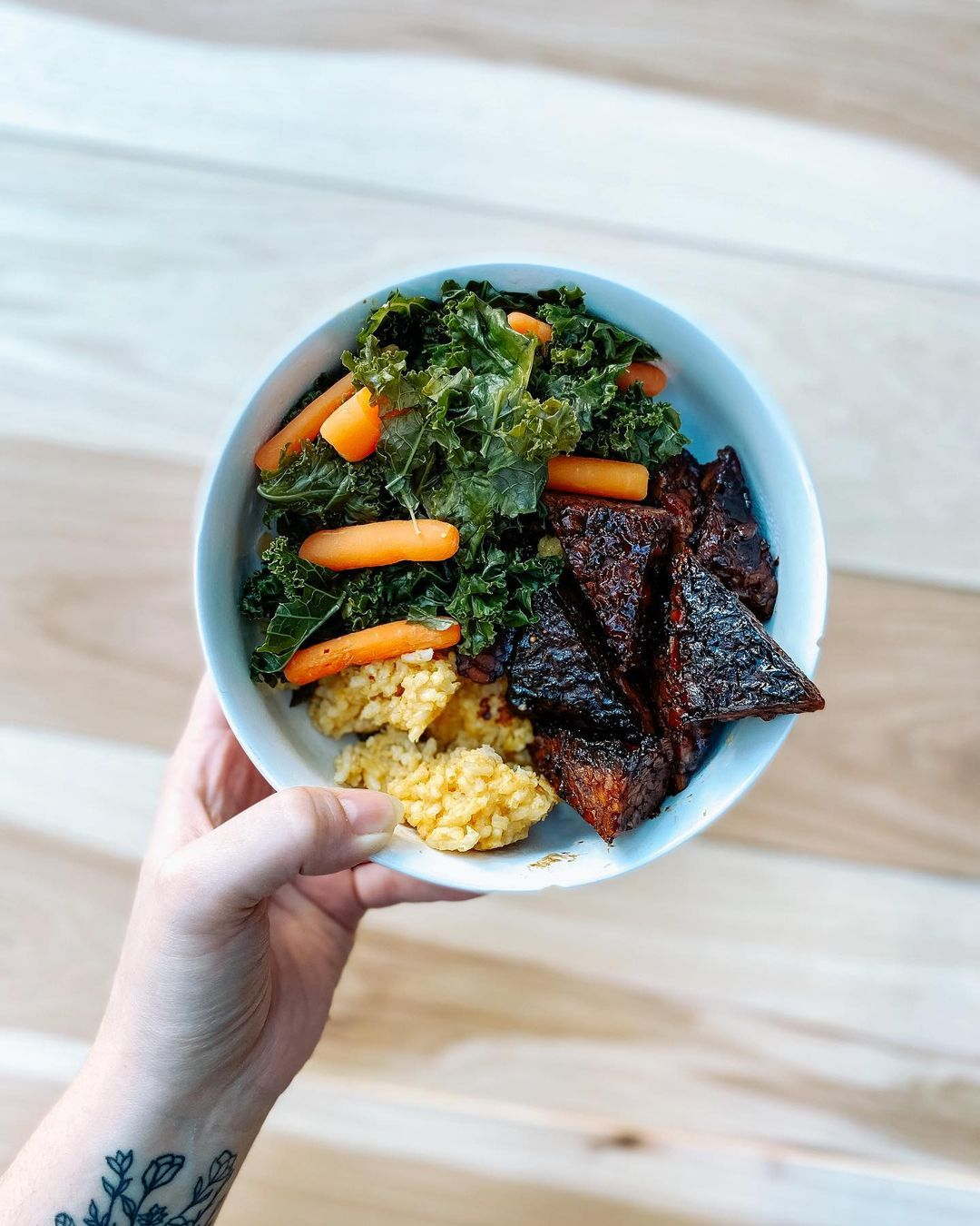 maple balsamic tempeh bowl with steamed veggies and coconut display image af