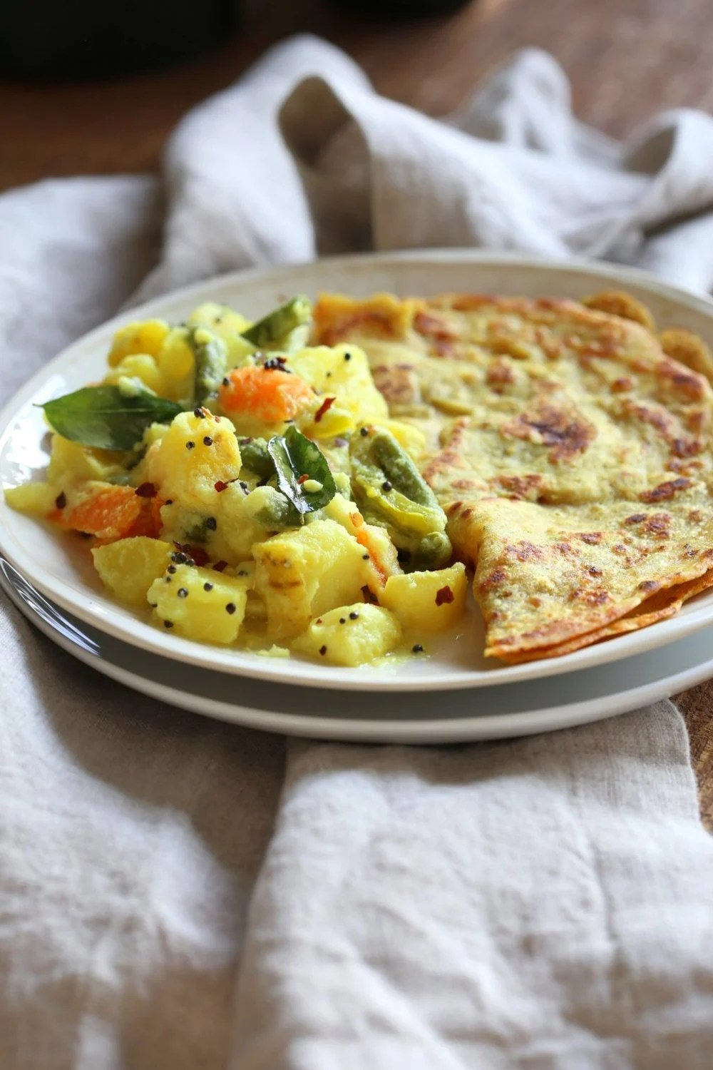 Avial - South Indian Veggie Coconut Curry. Seasonal Vegetables in easy spiced coconut sauce. Serve over rice, flatbread or dosa crepes. #Vegan #Indian #Glutenfree #Soyfree #Recipe #VEGANRICHA