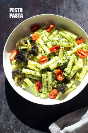 Vegan Pesto Pasta with Charred Broccoli. Easy Vegan Pesto with Ziti, served with roasted cherry tomatoes and broccoli. #Vegan #Soyfree #Recipe #VeganRicha. Can be #glutenfree and #nutfree | VeganRicha.com