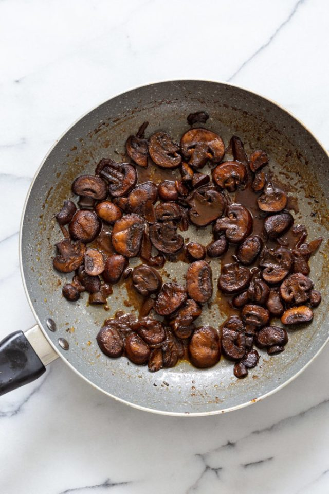 overhead shot of a pan with sauteed balsamic mushrooms
