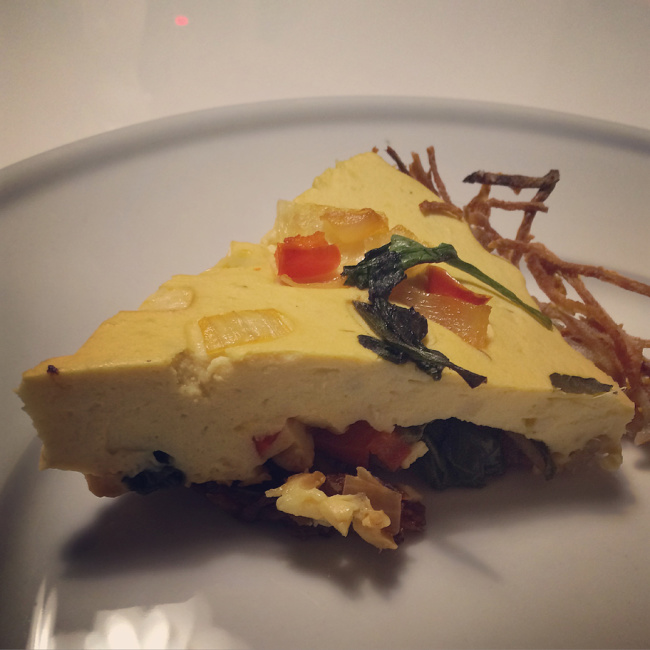 """Very clever dinner. Appetizing food fit neatly into interesting round pie. (It's a Quiche.)"""