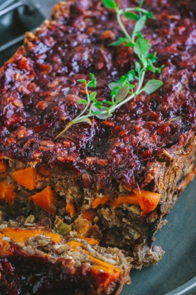 Picture of slice of vegan lentil loaf on green plate