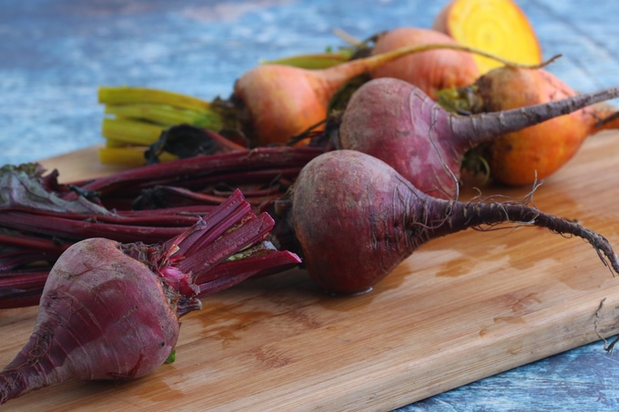 Picture of Red and Yellow Beetroots with some leaves attached
