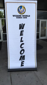 A large scroll at the entrance to the convention center