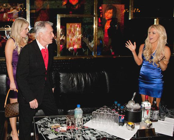 Hugh Hefner with Anna Sophia Berglund and his girlfriend Crystal Harris in Playboy Club