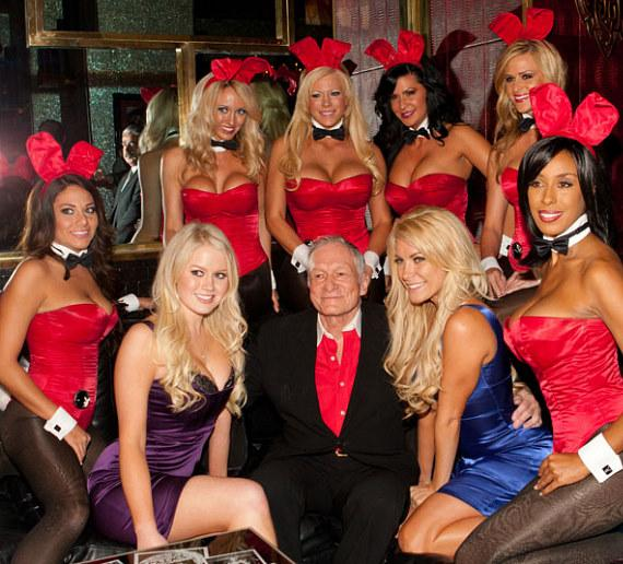 Playmate Anna Sophia Berglund (left, in purple), Hugh Hefner (center) and Crystal Harris (right, in blue) with Playboy Bunnies at the Playboy Club in Las Vegas in November, 2010