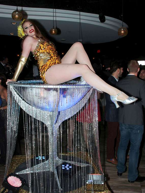 Showgirl in a life-size martini glass