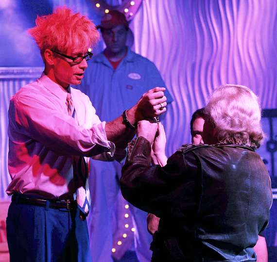 Murray escapes from Houdini's handcuffs in the Sin City Theatre in Planet Hollywood Las Vegas