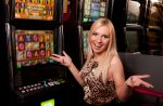 Young,Woman,In,Casino,On,A,Slot,Machine