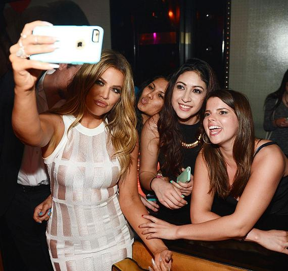 Khloe Kardashian takes a photo with fans at 1 OAK Nightclub at The Mirage Hotel and Casino