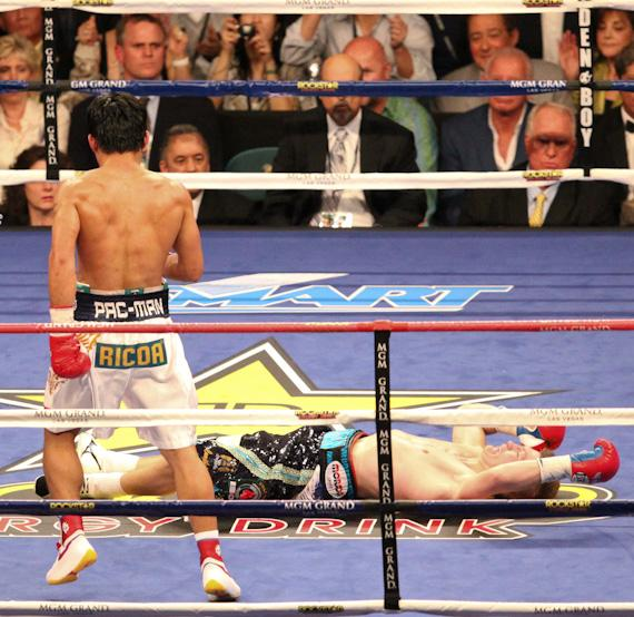 Pacquiao steps away as Hatton hits the canvas