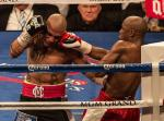 Mayweather in the corner, lands a right on Cotto