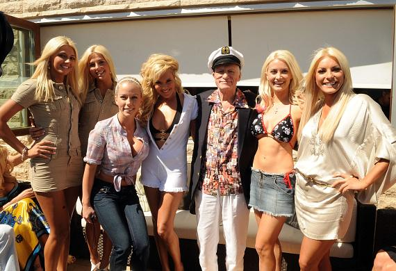 Hef and the girls from the pool party