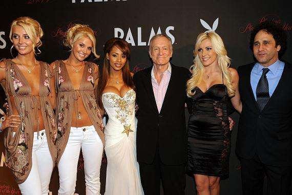 Hugh Hefner and Palms owner George Maloof with Playmates