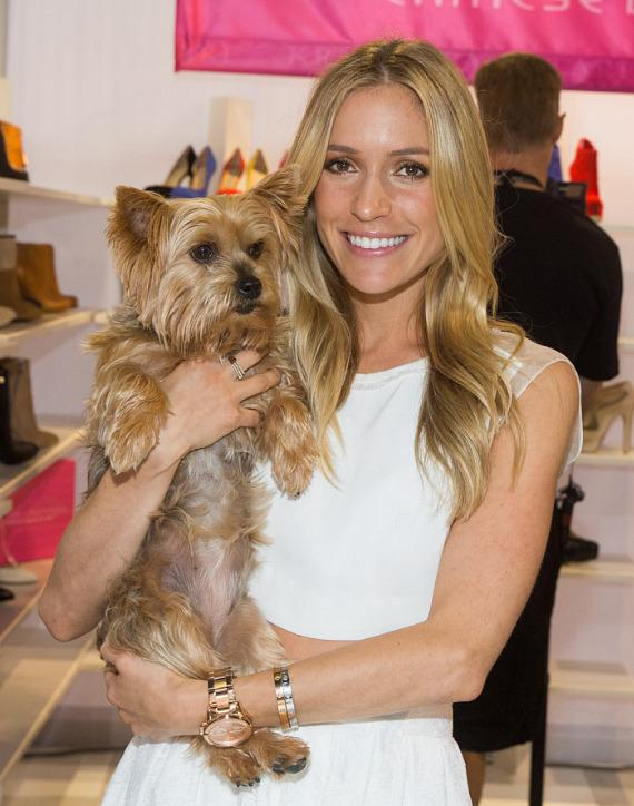 Kristin Cavallari with her dog Bardot in the Chinese Laundry booth at FN PLATFORM Trade Show