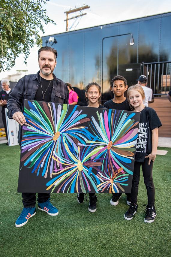 Culture Shock Las Vegas youth present Insomniac CEO and Founder, Pasquale Rotella, with original artwork