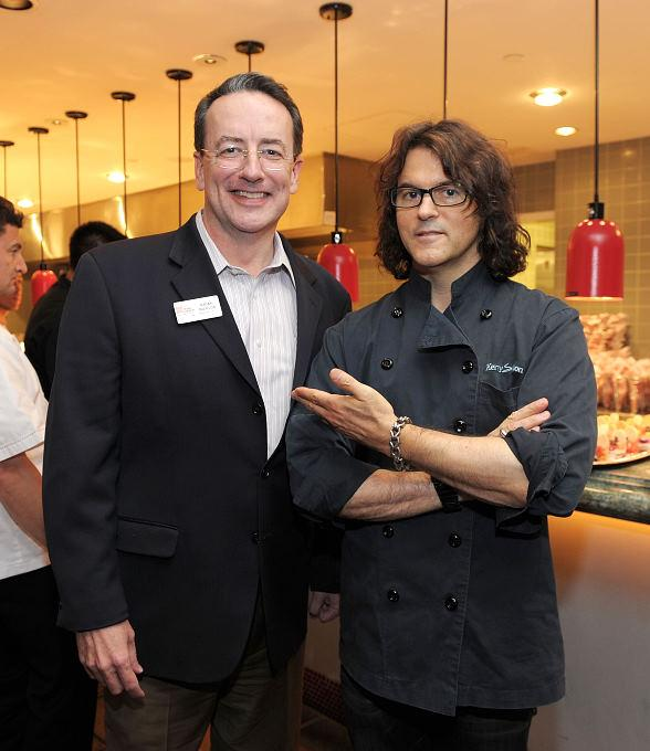 Brian Burton, CEO and President of Three Square, with Kerry Simon