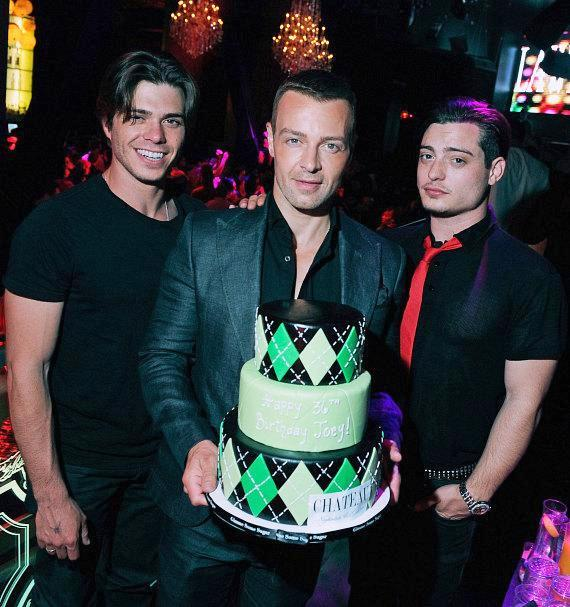 Brothers Matthew and Andrew pose with Joey (center) as he is presented with his birthday cake at Chateau Nightclub & Gardens