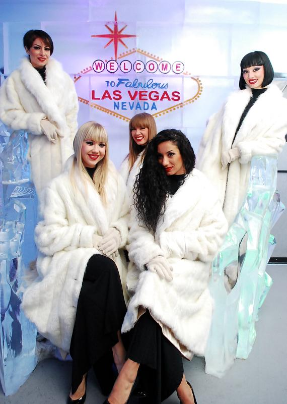 """Crazy Horse Paris ladies next to the """"Welcome to Las Vegas"""" sign at Minus5 Ice Bar"""