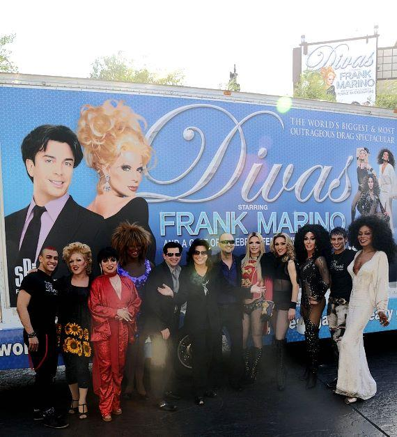 """Frank Marino, flanked by Alex Schechter on the left and Adam Steck on the right, as well as cast members of """"Divas Las Vegas"""" in front of the show's new mobile billboard"""